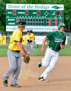 At right, the Hodags' Brandon Reinthaler rounds third base to score the first run.