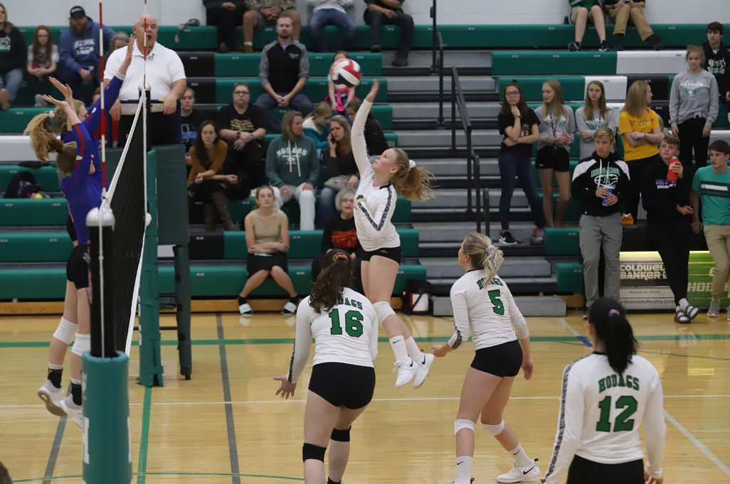 Emily Jorgensen hits a ball over the block attempt of Northland Pines.
