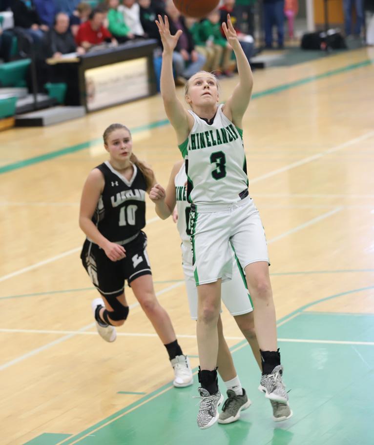 Ella Schiek grabs a defensive rebound.