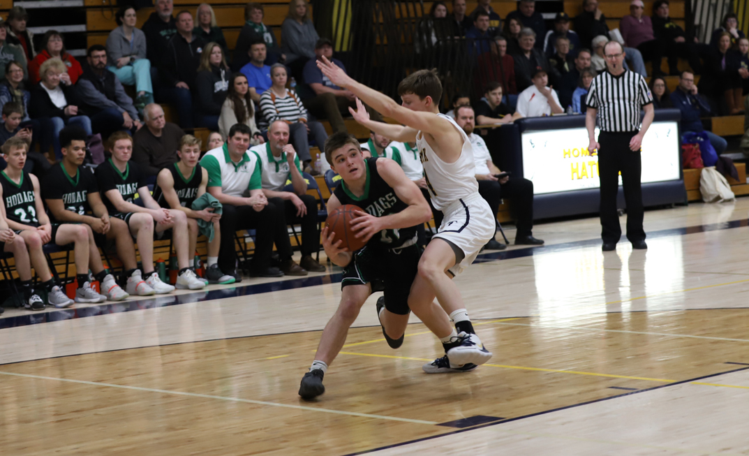 Senior Peyton Erikson drives to the basket and scores two of his 14 points.