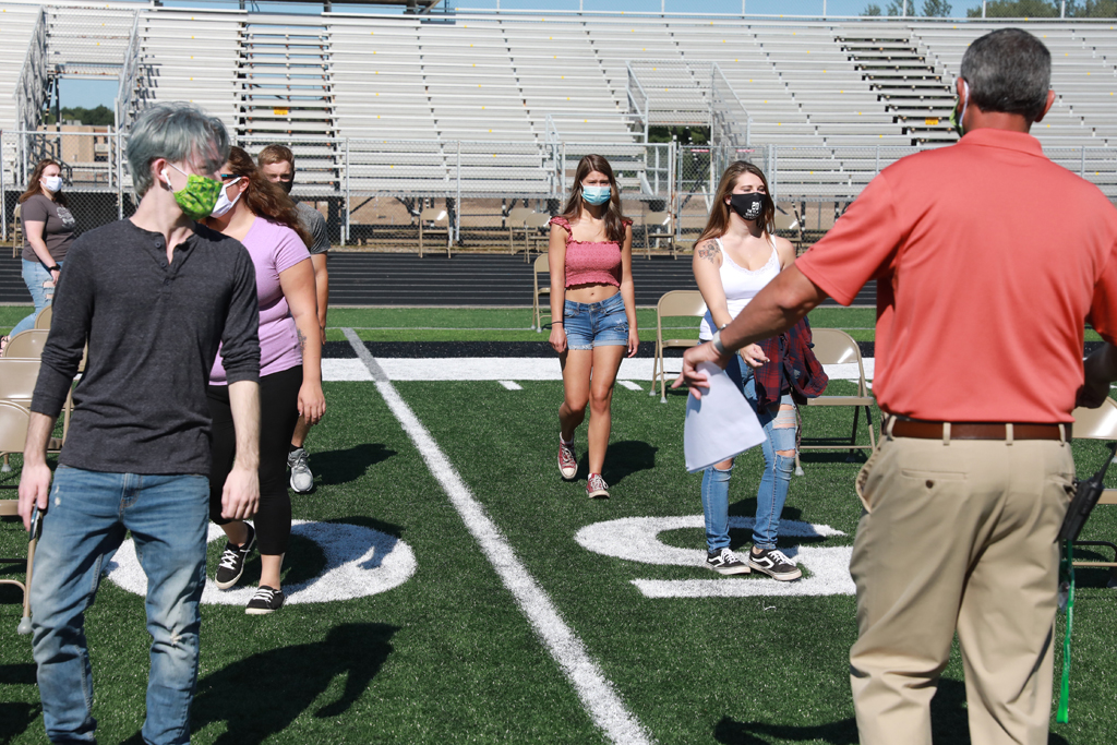 Principal Shane Dornfeld directs students to their seats at Friday's practice.