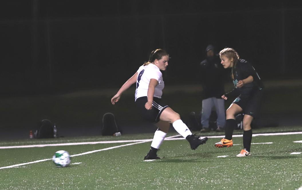 Freshman Emma Chiamulera gets the ball by a Mosinee defender.
